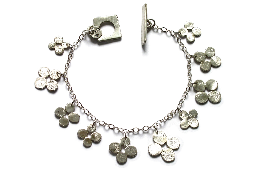 silver bloom charm bracelet   $250.00   item 04-464
