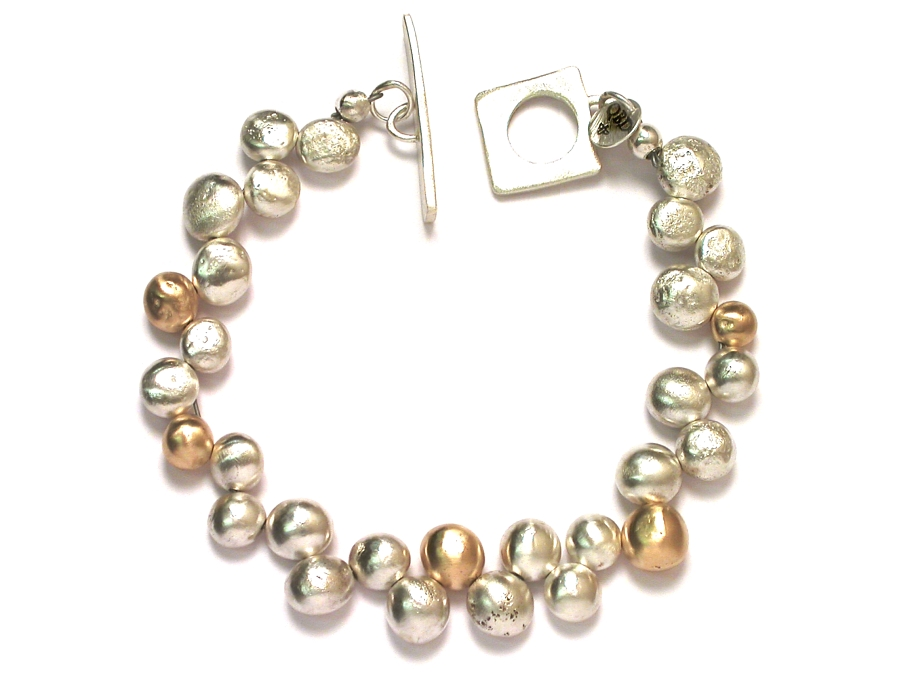 silver & 10K gold 'bubble' bracelet   $895.00   item 06-202