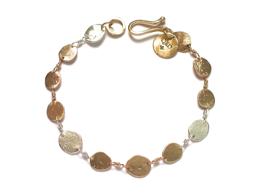gold & silver mini-disc bracelet   $440.00   item 07-225