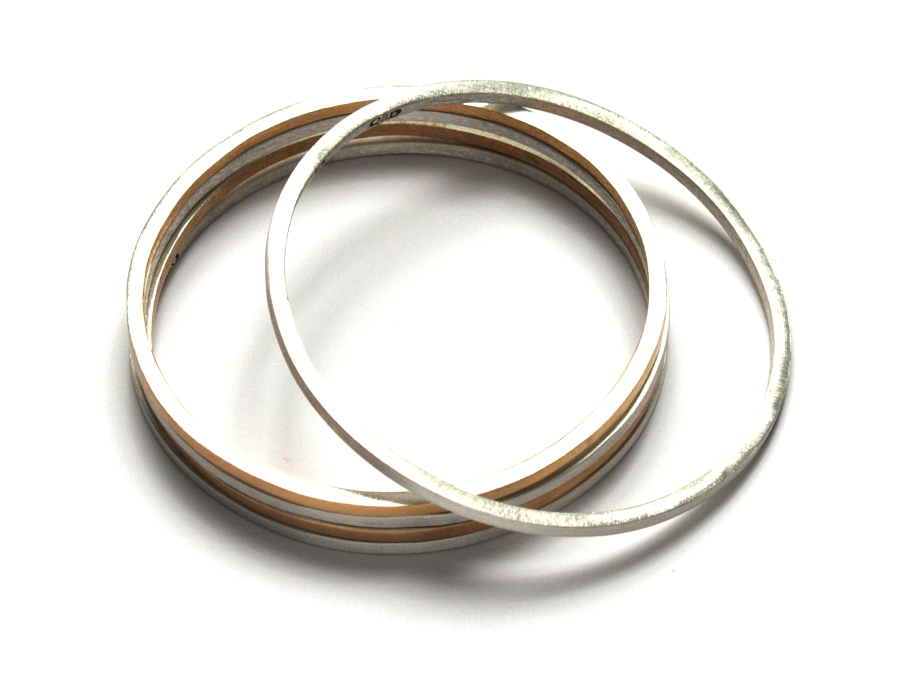 bangles - silver ($95 each) and silver with gold plated edges ($110 each)   $110.00   item 10-131