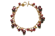reds & golds dangle bracelet   $220.00   item 04-043