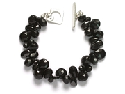 mixed onyx & black cz briolette bracelet   $140.00   item 06-218